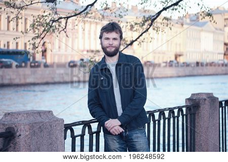 Handsome young man on the historical centre of St. Petersburg.