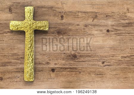 3d rendering gold cross with blank space on wooden background