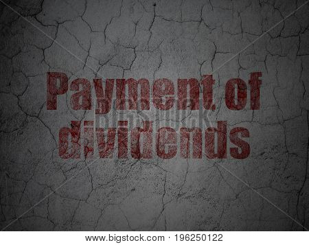 Currency concept: Red Payment Of Dividends on grunge textured concrete wall background