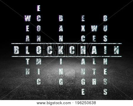 Banking concept: Glowing word Blockchain in solving Crossword Puzzle in grunge dark room with Dirty Floor, black background
