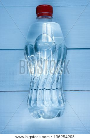 Bottle Of Clear Water On Table