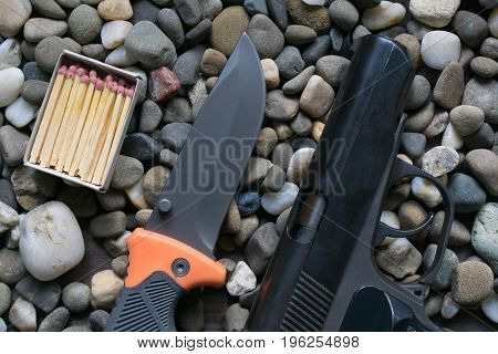 Survival Kit For Tough Man. Gun And Knife