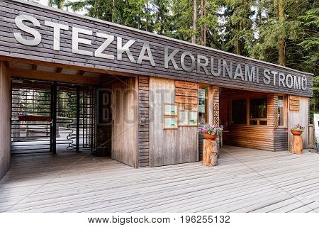 LIPNO CZECH REPUBLIC - 18 July 2017. Entry point to Treetop Sightseeing trail in tree crowns. Wooden construction with a slide in the middle. Touristic place. Treetop Walkway in Lipno Czech Republic