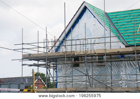 Elmstead Essex United Kingdom -17 July 2017: Scaffolding on side of new house