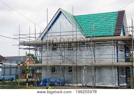 Elmstead Essex United Kingdom -17 July 2017: Scaffolding on side of new large house