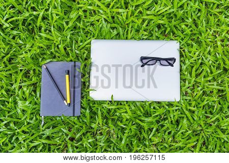 Workplace in the field grass education concept