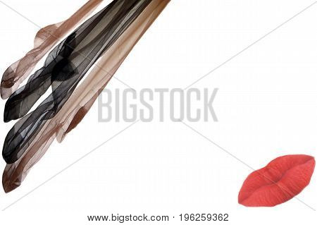 Attractive nylons stockings at the upper right edge of a stationery at the bottom left a red kiss mouth.