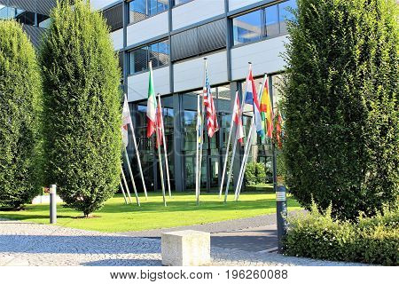 An image of flags infront of a building