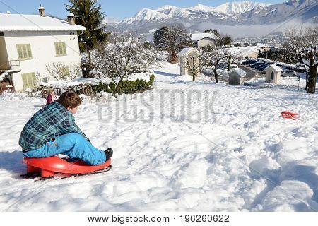 Boy Enjoy A Sleigh Ride At Lugano, Switzerland