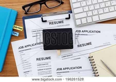Resume And Job Application With Blank Sign