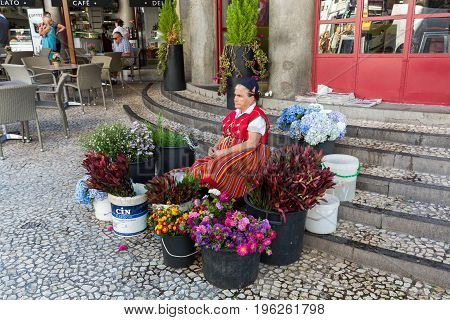 FUNCHAL PORTUGAL - SEPTEMBER 2 2016: Flower Seller outside the Mercado dos Lavradores (Workers Market) Funchal Madeira Portugal