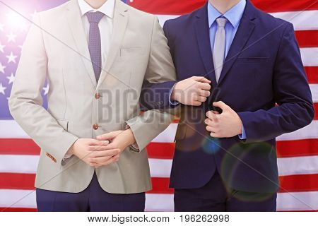 Gay couple and USA flag on background