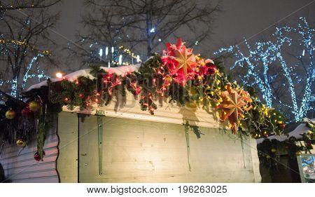 lighting christmas decorations in city street