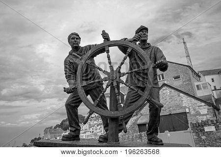 Man and Boy -by Elisabeth Hadley. Based on 'The Wheel' an etching by Arthur Briscoe (1873 - 1943) Brixham Harbour Devon July 2017