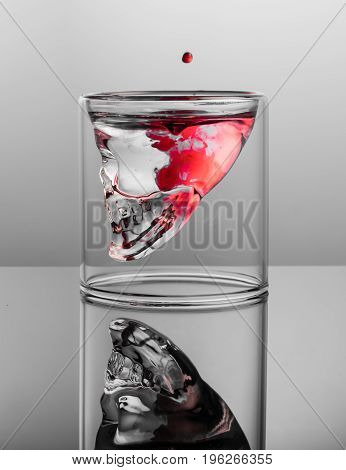 Dark thoughts. Negative with red stains in the glass skull.