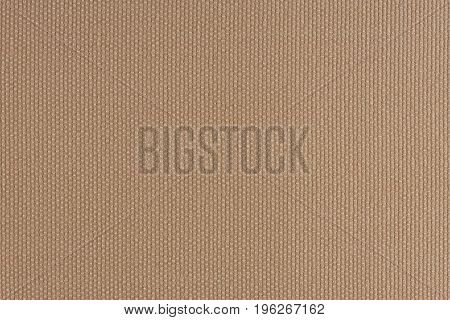 close up of a woolen fabric of beige color. Abstract background empty template.