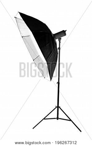 A modern electric saturated black octobox on a tripod. A huge octobox isolated over the white background. Equipment for photographers. Professional shooting in a photo studio.