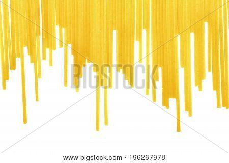 Bright yellow noodles isolated over the white background. Traditional delicious italian cuisine full of carbohydrate. Uncooked organized pasta noodles with a clipping path.