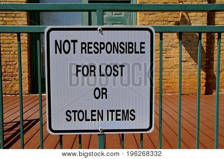A posted sign warns customers and visitors they are responsible for their own items