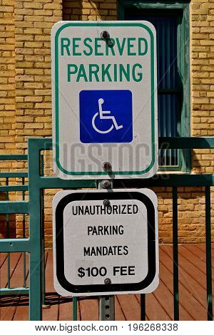 A sign prohibits parking except for the handicapped and the resulting fine