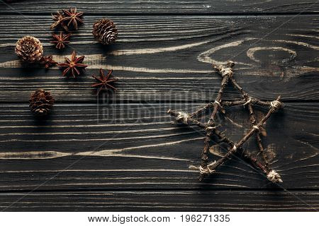 Stylish Simple Star And Anise And Pine Cones On Rustic Wooden Background. Winter Flat Lay. Eco Greet