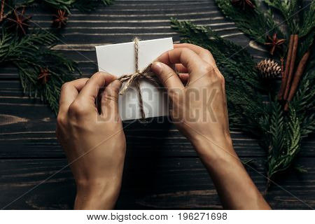 Hands Wrapping Christmas Simple Present On Stylish Rustic Wooden Background Flat Lay With Space For