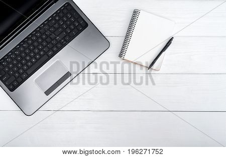 Wooden White Office Desk Table With Open Blank Laptop Computer And Empty White Diary With Pen, Free