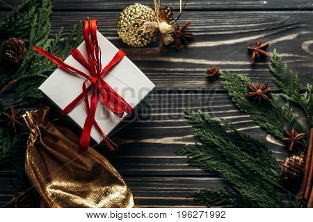 Stylish Christmas Flat Lay Presents With Red Ribbon And Golden Ornaments On Rustic  Wooden Backgroun