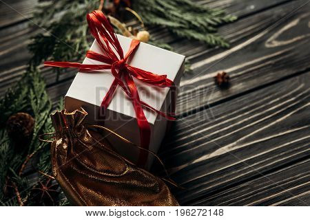 Christmas Presents With Red Ribbon And Golden Ornaments On Stylish Rustic Wooden Background With Gre
