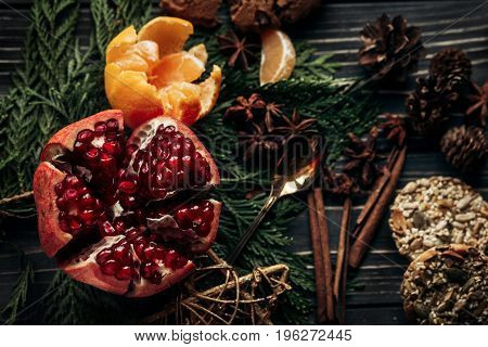 Stylish Rustic Winter Flat Lay With Gingerbread Cookies Garnet Oranges And Spices On Fir Branches On