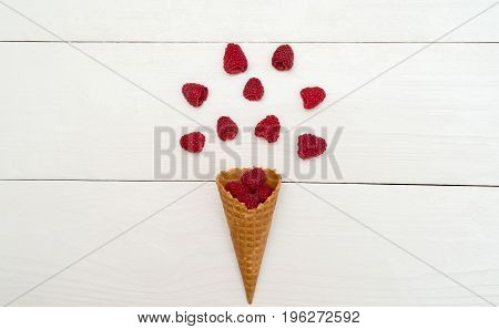 Top View Of Sweet Fresh Organic Raspberries In Waffle Cone, Free Space. Fresh Berries In Cone On Whi