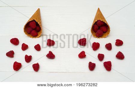 Sweet Fresh Organic Raspberries In Waffle Cones. Fresh Berries In Cones On White Wooden Background W