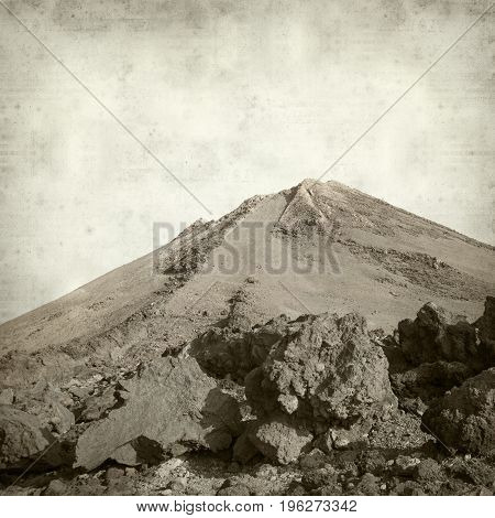 textured old paper background with the very top of volcan Teide on Tenerife