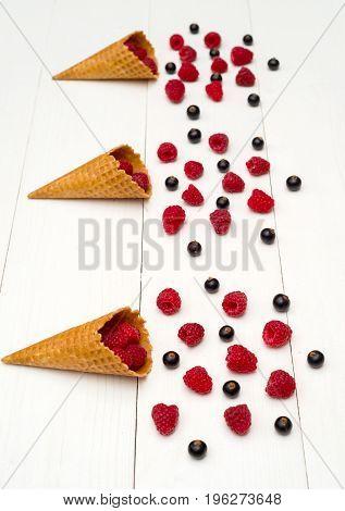 Sweet Fresh Organic Raspberries And Blackberries In Waffle Cones. Fresh Berries In Cones On White Wo