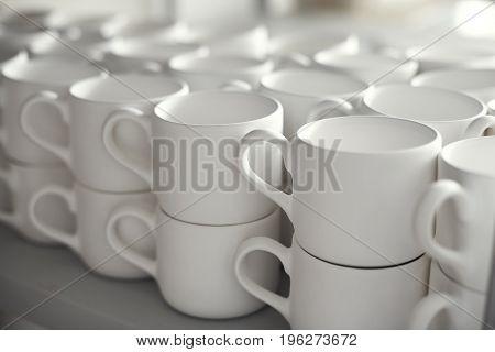 Blank ceramic cups kiln in a studio