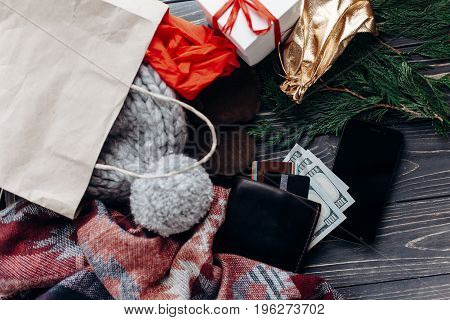 Credit Cards Money Wallet And Phone With Empty Screen On Wooden Rustic Background With Bags Presents
