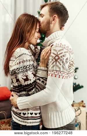 Stylish Happy Couple Sensually Kissing At Christmas Tree. Joyful Cozy Moments In Winter Holidays. Se