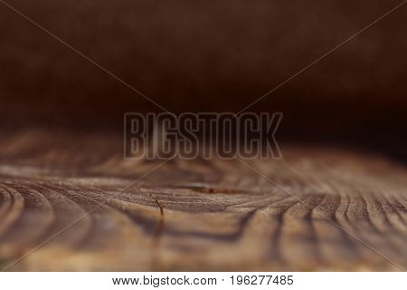 Close up of dark rustic wooden structure with short depth of field for a background concept