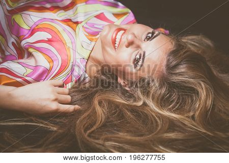 smiling young blonde beauty woman  portrait with long hair lie down studio shot