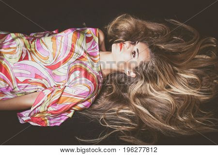 young blonde beauty woman  portrait with beautiful very long hair lie down studio shot