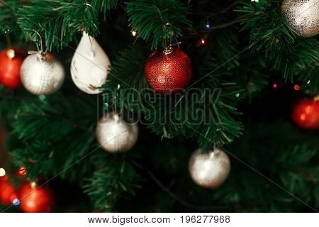 Decorated Christmas Tree With Red And Silver Balls Ornaments Close Up At Home For Holiday Season On