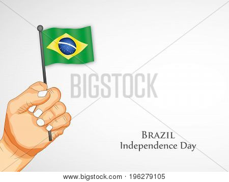 illustration of hand holding Brazil flag with Brazil Independence Day text on the occasion of Brazil Independence Day