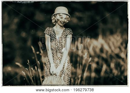 Classic Black And White Photo Of 1920S Summer Fashion Woman With Dress And Straw Hat Standing With H