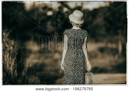 Classic Black And White Photo Of Vintage 1920S Summer Fashion Woman With Dress And Straw Hat Standin