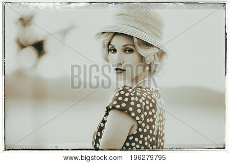 Classic Black And White Photo Of Seductive Looking Woman Wearing Vintage 1930S Fashion. Standing In