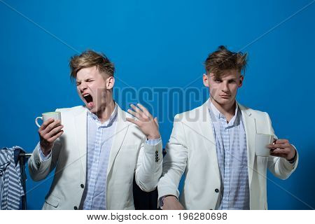 Twins In Jacket With Cup.
