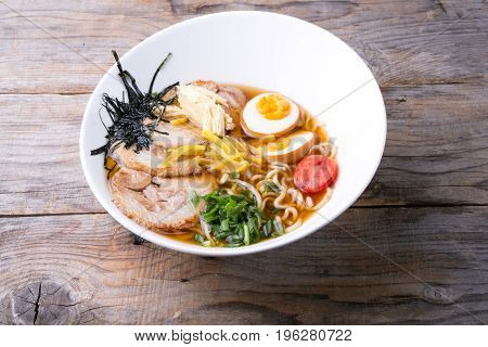 Traditional japanese ramen noodles soup with meat