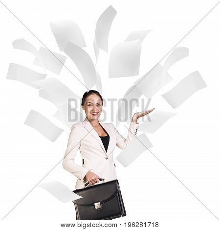 Happy business woman under falling pages isolated on white.