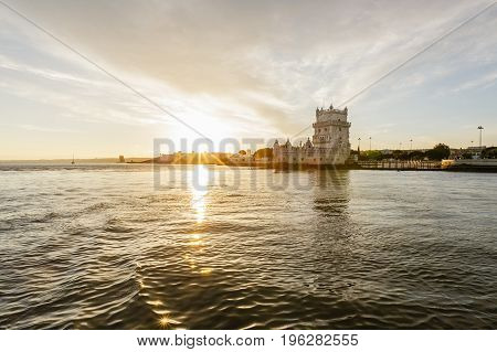 River view at sunset of Belem Tower in Lisbon Portugal