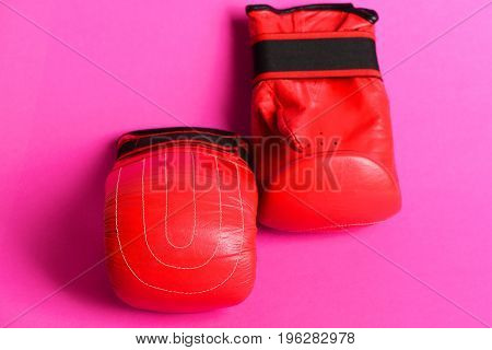 Pair Of Red Gloves For Box Placed In Geometrical Pattern